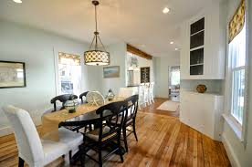 dining room traditional chairs and oval table on wooden flooring