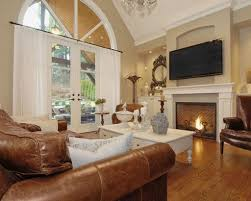 Traditional Family Rooms by Brown Leather Sofa Set And Classic Fireplace Using Traditional