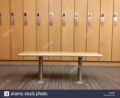 bench and lockers in a fitness facility stock photo royalty free