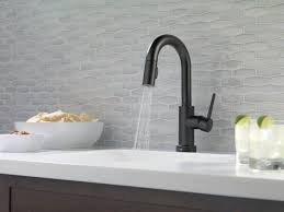 overstock faucets kitchen modern kitchen with white countertops and black faucet using an
