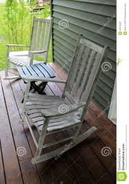 Rocking Chairs On Porch Rustic Rocking Chairs And Table On Wood Porch Stock Photo Image