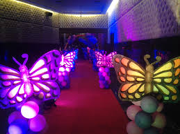 pretty wedding pathway decor with arranged butterfly design unify