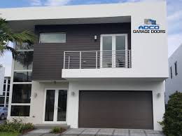 new garage doors from clopay u0027s modern steel collection give this