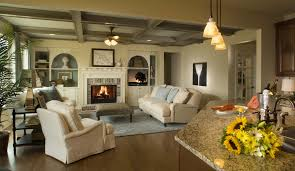 small family and living room with l shaped brown sofa white wicker