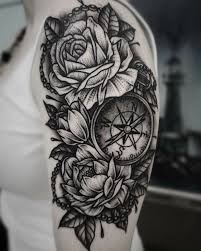 black shoulder tattoo arm blackwork flowers shoulder tattoo slave to the needle