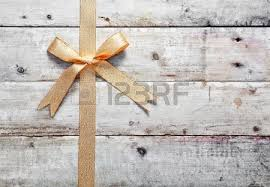 rustic ribbon festive ornamental gold ribbon and bow on a grunge rustic wood