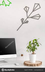 minimalist workstation with a potted plant u2014 stock photo
