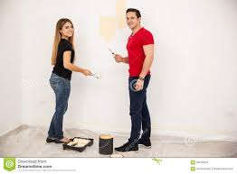 painting a wall cute couple painting a wall stock photo image 56549254