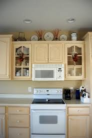 how to decorate top of kitchen cabinets most significant top kitchen napolis home decor color photos cabinet