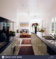 White Galley Kitchen Pictures Rugs On Floor In Open Plan White Galley Kitchen With Black
