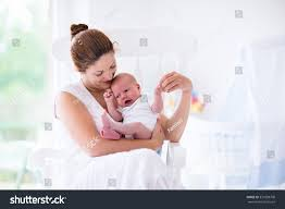 Rocking Chairs For Nursing Mothers Young Mother Holding Her Newborn Child Stock Photo 331898708