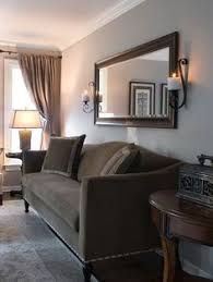Mirror Over Dining Room Table - behind couch wall in living room mirror frame sconces and metal