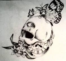 skull butterflies on right back shoulder