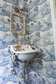 sapphire blue wallpaper sapphire toile wallpaper french bathroom the decorologist