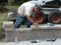 Snap Together Patio Pavers by How To Build A Kidney Shaped Patio And Sitting Wall How Tos Diy