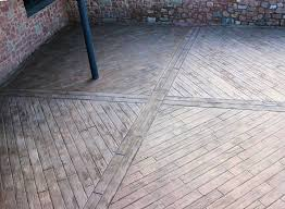 Stamped Concrete Backyard Ideas by Stamped Concrete With Faux Wood Grain Herringbone Pattern The