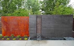large poured concrete water feature in modern steel arbor and