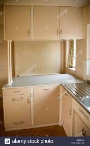 old fashioned fitted cupboards in a domestic 1950s kitchen built