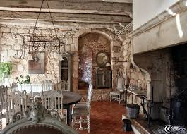 remarkable stone wall of family and dining room which is decorated