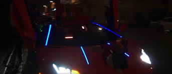 Lamborghini Aventador Neon - youtuber dresses up his lamborghini aventador as fire spitting