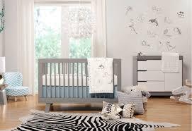 baby nursery with grey crib and zebra printed rug safety tips