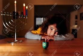 chanukah days girl plays with dreidel during the of hanukkah