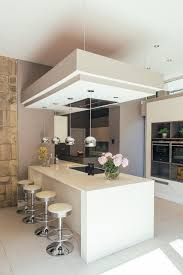 Transitional Pendant Lighting Kitchen - cream pink kitchen contemporary with stone feature wall mini