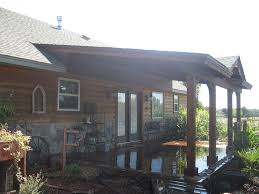 Backyard Patio Covers Roofed Backyard Patio Cover With Sunburst Hundt Patio Covers And