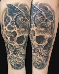 black ink skull with owl design for arm by spencer caligiuri