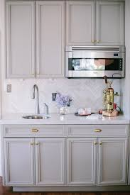 what color hardware looks best on gray cabinets look we gray kitchen cabinets with brass hardware
