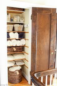 an organized linen closet makeover how to get maximum storage in
