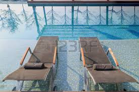 inside swimming pool swimming pool made by mosaic tiles with small stairs inside the