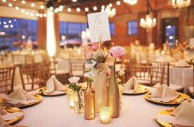 gold wine bottle table numbers empty glass bottles fill in as gorgeous wedding centerpieces empty