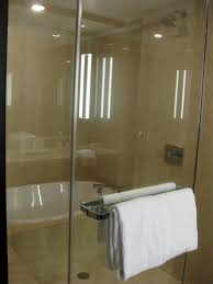 shower and tub together freestanding or built in tub which is awesome modern bathroom design ideas feature cream granite wall and white ceramic bathtub with cream granite appealing modern small bathroom with shower