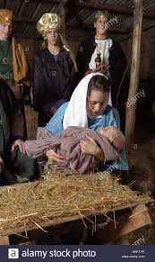 mary and baby jesus in live nativity scene stock photo royalty