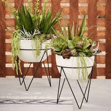 ikea planter hack plant stand style with a modern twist