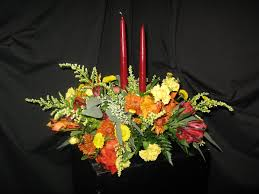 thanksgiving williamsburg fall centerpiece with two candles arrangement williamsburg floral
