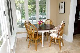 Country Dining Room With Travertine Tile Floors  High Ceiling In - Ohana white round dining room set