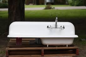 simple farmhouse sink with drainboard and backsplash board farm