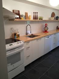 home design cozy black tile flooring with wood countertop and