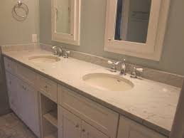 white marble bathroom vanity top connected by double white sinks