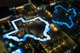 Zoo Of Lights Houston by Marriott Marquis Houston Debuts Texas Shaped Pool In Grand Opening
