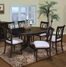 furniture dark wood oval dining table with decorative plant on