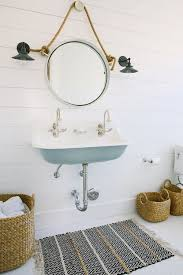 nautical bathroom mirrors nod to nautical bathroom nautical rooms that are subtle stylish livable apartment therapy