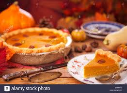 home made fall decorations homemade pumpkin pie on a rustic table with autumn decorations