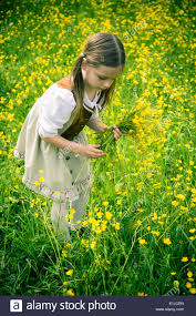 little wearing country style dress collecting buttercups