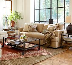decorating pottery barn living room with glass coffee table on