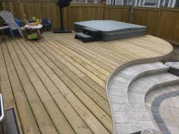 pressure treated deck with curves pvc trim and stone steps