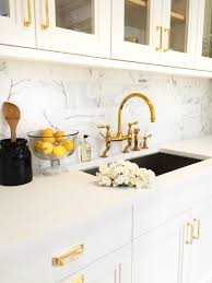 swooning over white kitchens with gold hardware