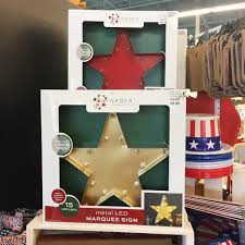 4th of july patio decor here today stores i brought home one of these gold light up stars and this flower flag spinner too